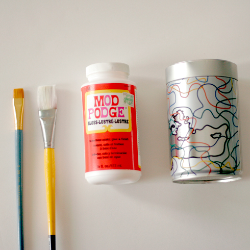 DIY supplies for collage art on coffee can